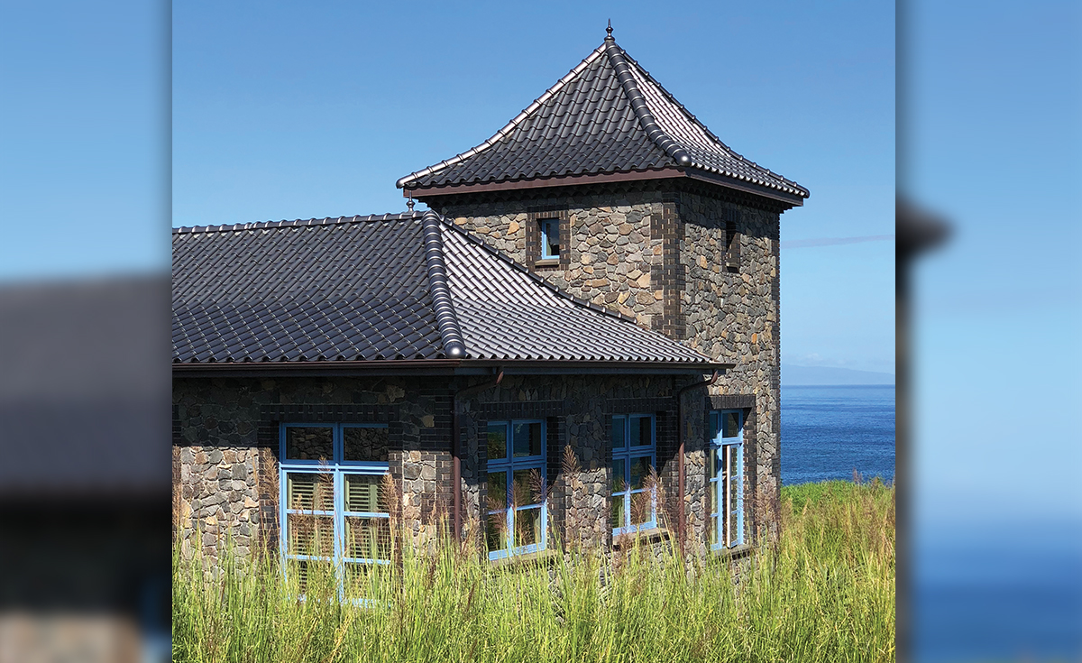 French Chateau inspired home with Improved S clay roof tile with genoise eave in C23 Metallic Silver Clay Roof Tile in Maui, HI