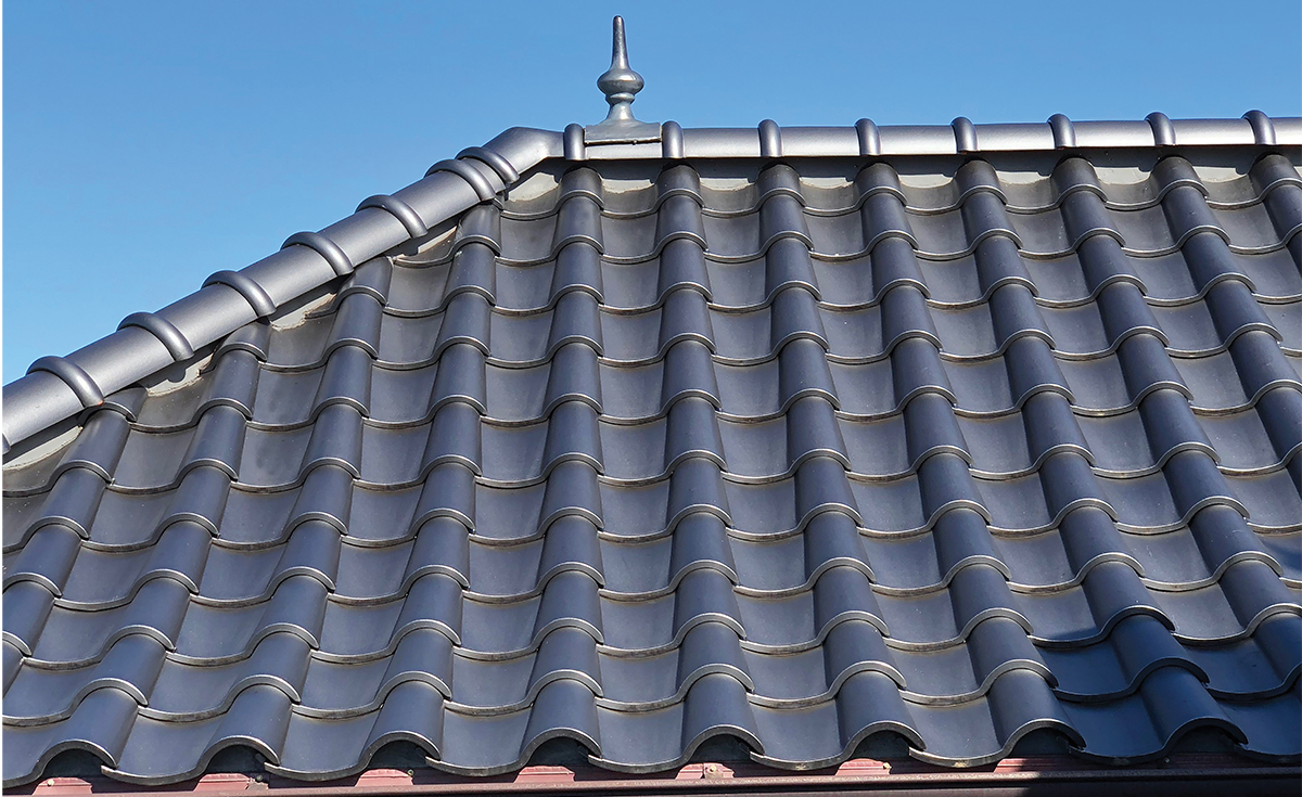 Detail of French Chateau inspired home with Improved S clay roof tile with genoise eave in C23 Metallic Silver Clay Roof Tile in Maui, HI