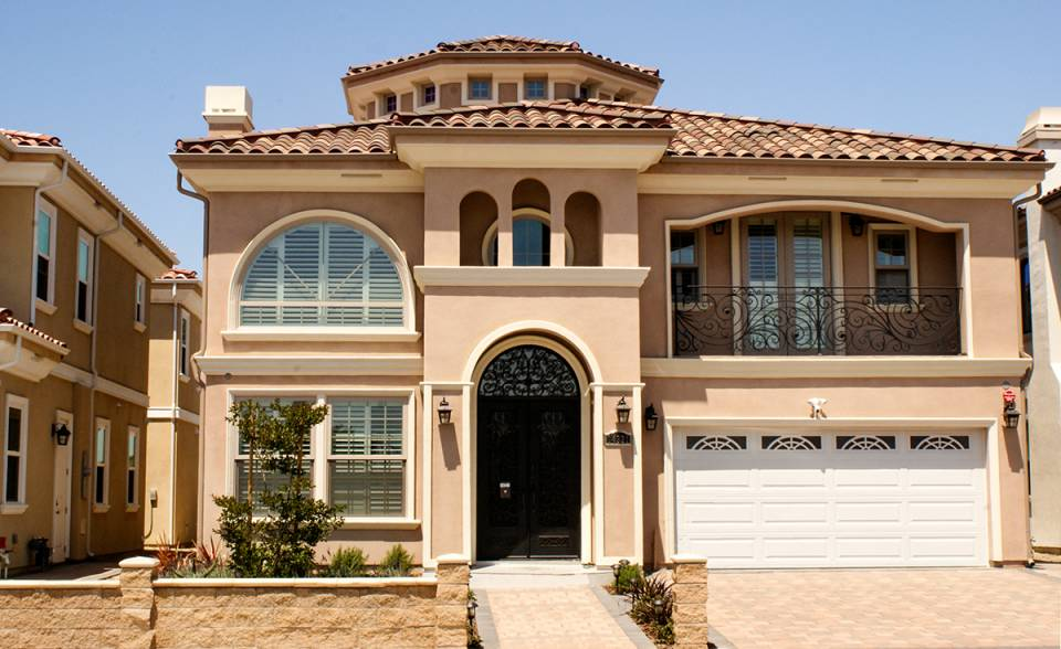 One Piece S Mission clay roof tile in B350 Old Barcelona Blend color on Mediterranean style two story custom home in Garden Grove California.