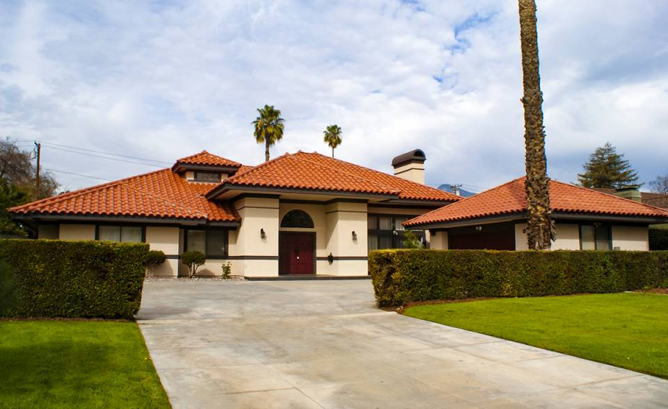 Landscape view of single story home with Corona Tapered mission two piece clay roof tile in F40 Natural Red located in San Marino, CA.