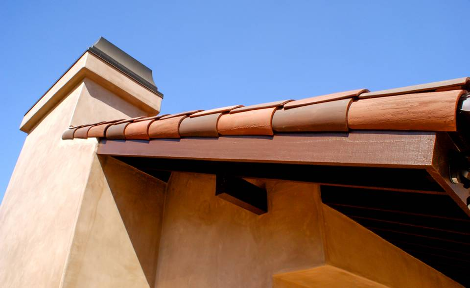 Gable detail of Classic S mission clay roof tile with 2 piece eave line in 1/3 B330-R Old Santa Barbara Blend, 1/3 2F45-SC Tobacco Sand Cast, and 1/3 2F45CC16D Tierra Brown Dark (Smooth) on custom home in El Cajon, California