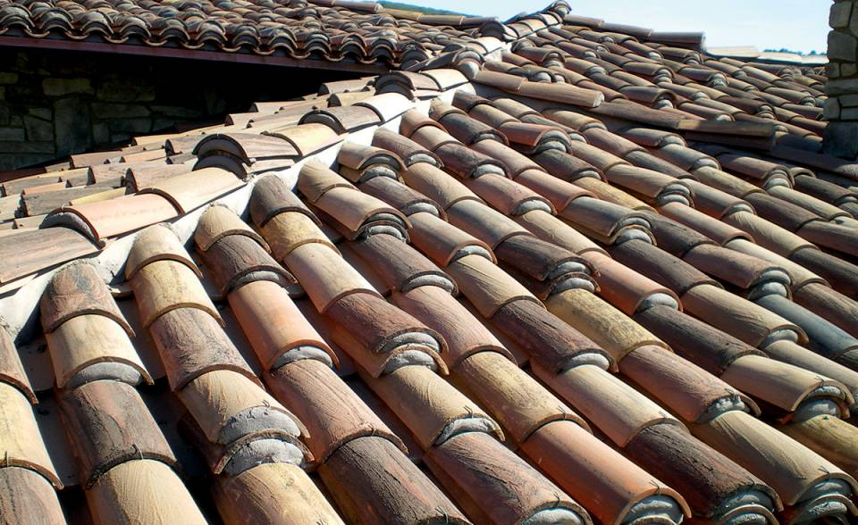 Classic tapered mission clay roof tile in 30% tierra brown, 15% cafe mocca, 15% Vintage Carmel, 15% Cinnamon sandcastle with Maganese, 15% Vintage Red Dark and 10% Tuscan Gold with Sand Cast