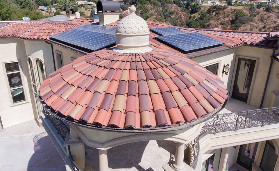 Close up of a dome roof installation on a custom mansion on a hilltop in Bradbury California featuring Classic Tapered two piece terra-cotta clay roof tile with turrets, domes, and dome awnings in custom color blend CB477.