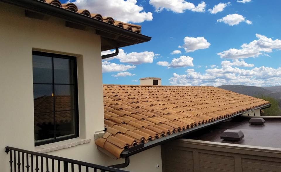 "Classic ""S"" Mission Clay Roof Tile in CB46-SC Rustic Tuscan Blend with Enhanced Starter Eave Application Home in Coral Canyon at Crystal Cove, Newport Coast, CA"