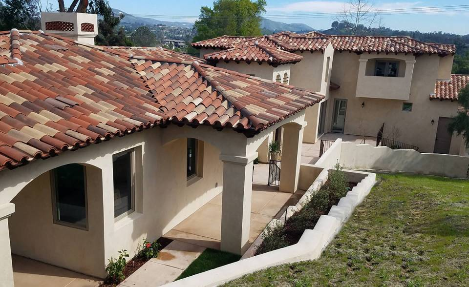 Classic S Mission clay roof tile in 50% B330-R Old Santa Barbara Blend, 20% B334-Rustic Ivory Blend, 20% B318-R Cafe Rustic Blend, and 10% B331-R Zorro Blend on home in Encinitas, CA