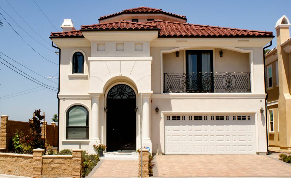 One Piece S Mission clay roof tile in B220 Madrid Blend on Mediterranean style two story custom home in Garden Grove California.