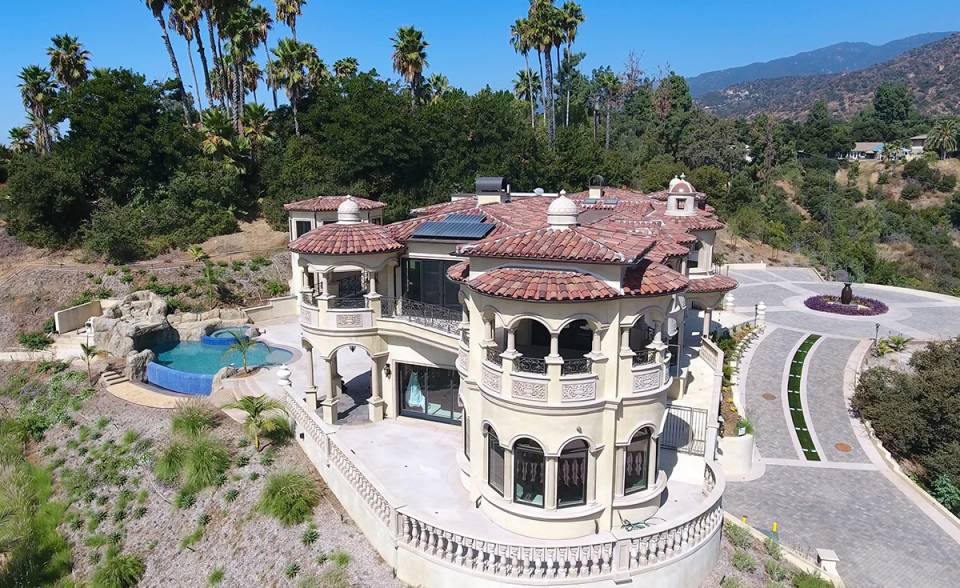 View of dome awnings and roof on custom mansion on a hilltop in Bradbury California featuring Classic Tapered two piece terra-cotta clay roof tile with turrets, domes, and dome awnings in custom color blend CB477.
