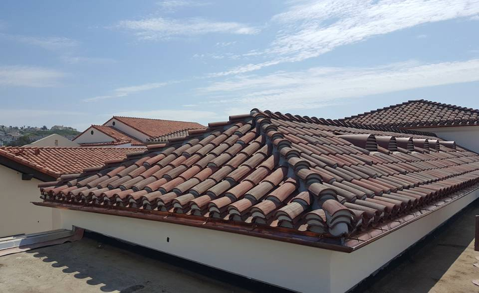 corona tapered mission two piece clay roof tile with mortar and boosting in various custom blends on rooftop of outlets at san clemente california.